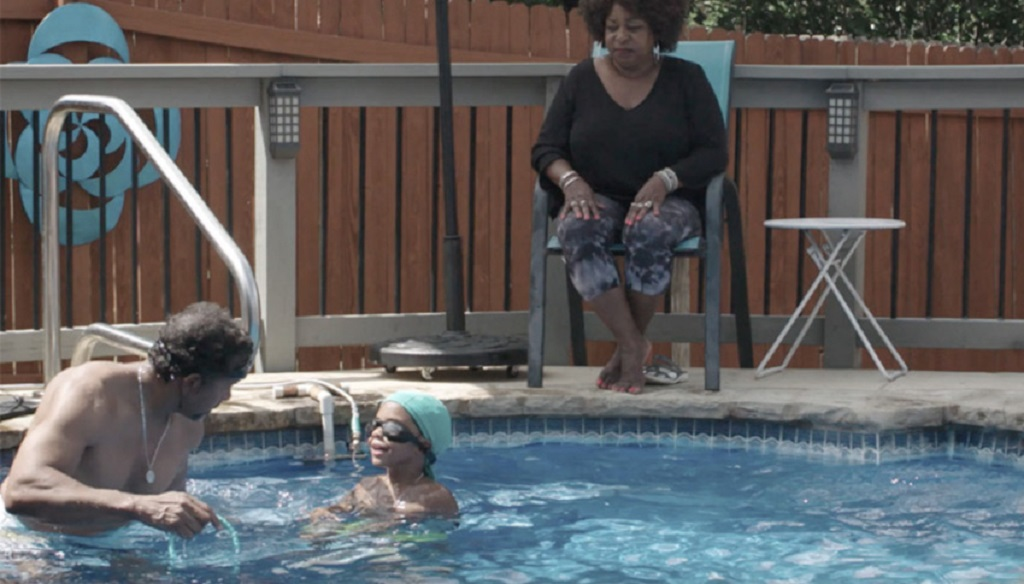Video preview of Ethan and his family swimming in the pool.