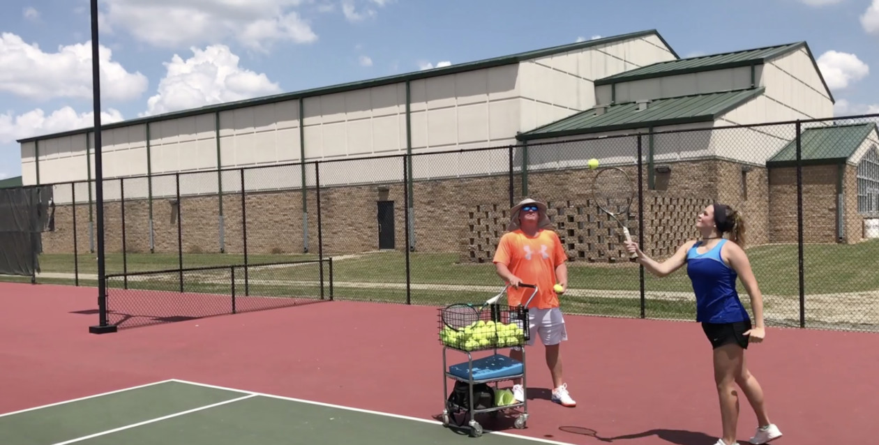Video preview of Katie practicing tennis.