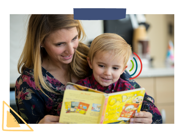 A mom reads a book aloud to her son who is deaf and wearing hearing aids.