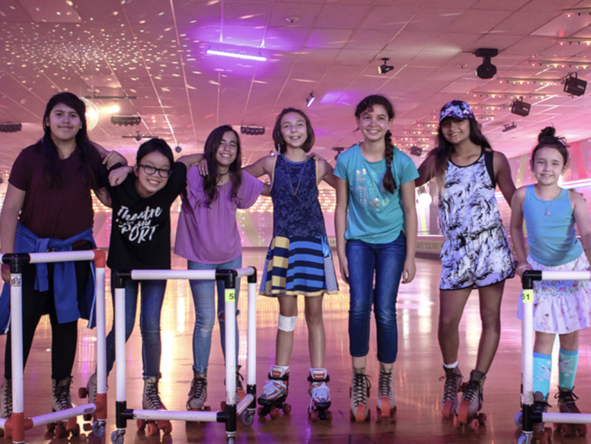 Sophie poses with her friends from school at the roller blading rink.