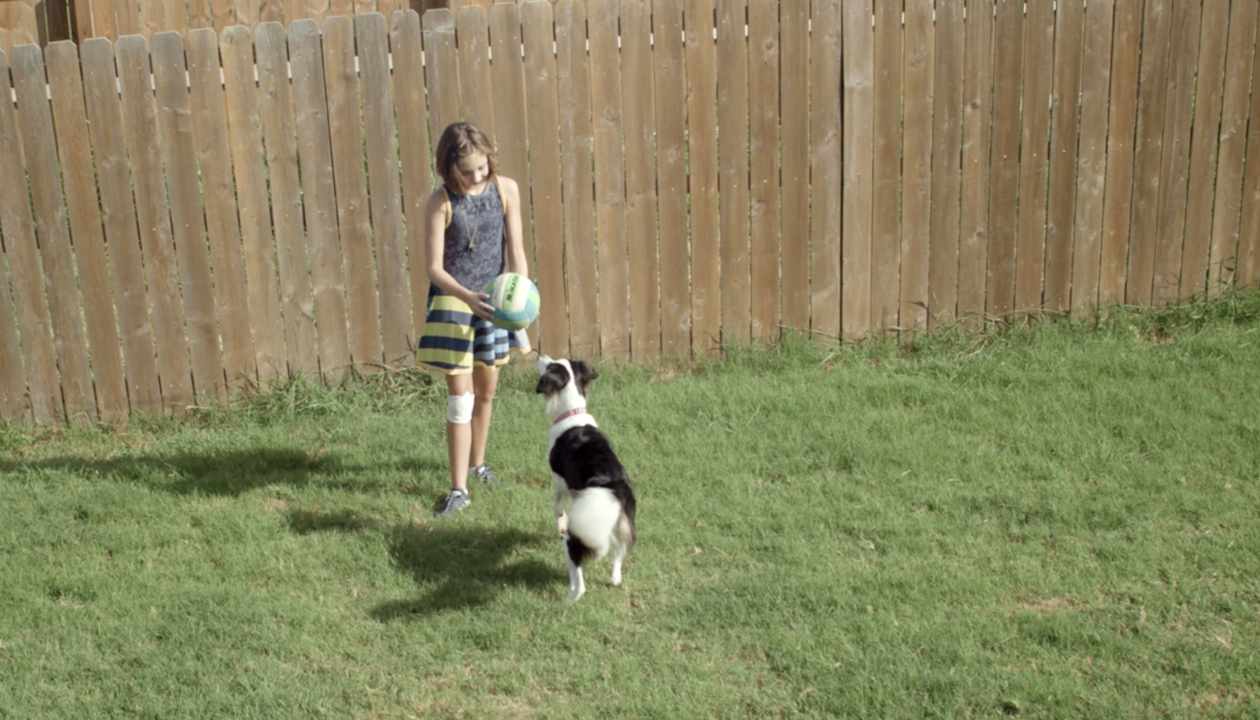 Video preview of Sophie playing with her dog in the back yard.